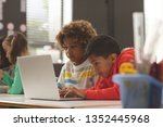 front view of two school kids... | Shutterstock . vector #1352445968