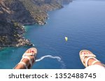 woman paragliding above perfect ...   Shutterstock . vector #1352488745