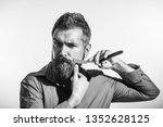 beard styling cut. barbershop...   Shutterstock . vector #1352628125