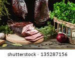 Freshly smoked ham in a rural pantry - stock photo