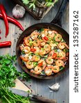 Fresh vegetables and shrimps on old pan - stock photo