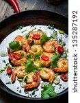 Cooking shrimps with fresh herbs - stock photo