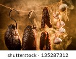 Ham, sausage and garlic in a homemade smokehouse - stock photo