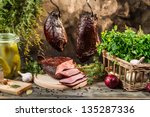 Smokehouse ham preparation for smoking in countryside - stock photo