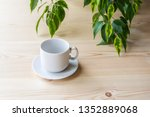 empty white cup with saucer for ... | Shutterstock . vector #1352889068