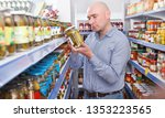 portrait of man customer... | Shutterstock . vector #1353223565