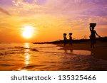 indian women carrying baskets | Shutterstock . vector #135325466