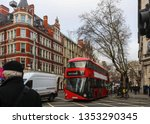 busy london intersection on... | Shutterstock . vector #1353290345