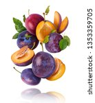 Stock photo flying in air fresh ripe whole and cut plums with leavs isolated on white background high 1353359705