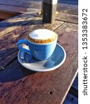 outdoor macchiato in a blue cup  | Shutterstock . vector #1353383672