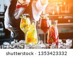 bartender making red sangria in ... | Shutterstock . vector #1353423332