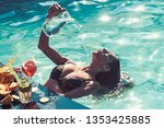 refreshment and swimming in... | Shutterstock . vector #1353425885