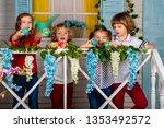 beautiful children hold easter... | Shutterstock . vector #1353492572