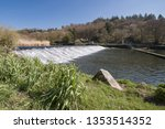 Small photo of Lopwell Dam opr Weir. River Tavy. Plymouth Devon England UK. Lopwell Dam (Weir) situated in the South West of England. The River Tavy is a tributary of the River Tamar.
