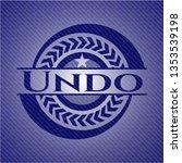 undo badge with denim background | Shutterstock .eps vector #1353539198