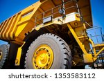 A Large Yellow Truck Used In A...