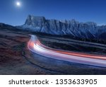 blurred car headlights on... | Shutterstock . vector #1353633905