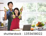 Asian Couple\'s In Apron Make...