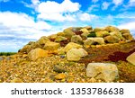 Mound of stones. Stone barrow. Barrow stones. Mound stones