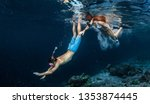 young couple snorkeling and do...   Shutterstock . vector #1353874445