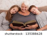 senior woman and its grandsons... | Shutterstock . vector #135388628