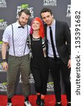 Small photo of Musicians Jeremy Davis, Hayley Williams & Taylor York of Paramore at the 2013 MTV Movie Awards at Sony Studios, Culver City. April 14, 2013 Los Angeles, CA Picture: Paul Smith