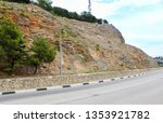 grid on the rock along the road.... | Shutterstock . vector #1353921782