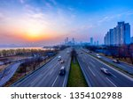 sunrise and traffic of seoul ... | Shutterstock . vector #1354102988