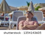 cute man in sunglasses and... | Shutterstock . vector #1354143605