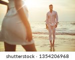 attractive young couple on the...   Shutterstock . vector #1354206968