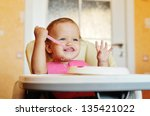 laughing eating baby girl with... | Shutterstock . vector #135421022