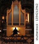 Man Playing Pipe Organ In A...