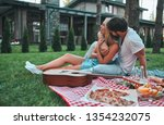 romantic couple hugging while... | Shutterstock . vector #1354232075