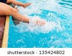 children legs in the water...   Shutterstock . vector #135424802
