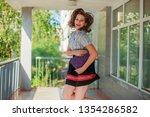 girl schoolgirl playing at... | Shutterstock . vector #1354286582