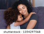 close up biracial family... | Shutterstock . vector #1354297568