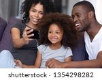 cheerful african family with... | Shutterstock . vector #1354298282