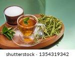 stevia dry leaves and stevia... | Shutterstock . vector #1354319342