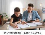 dad helping his son with...   Shutterstock . vector #1354461968
