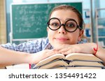 female student with many books... | Shutterstock . vector #1354491422