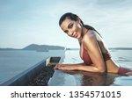 sensual  young woman realxing... | Shutterstock . vector #1354571015