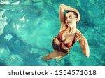 sensual  young woman realxing... | Shutterstock . vector #1354571018