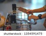 hand of traveler or tourist... | Shutterstock . vector #1354591475
