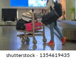many suitcases and luggages in... | Shutterstock . vector #1354619435