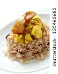 Small photo of saltfish with ackee and jollof rice on white