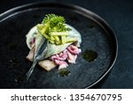 Stock photo herring elegant plate restaurant gourmet onion sauce plate exclusive food fish fillet elegant black 1354670795