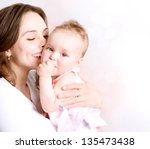 Mother And Baby Kissing And...