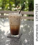 iced caramel macchiato   | Shutterstock . vector #1354751315