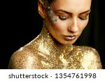 beauty close up portrait in gold | Shutterstock . vector #1354761998