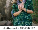 mother and son. son hugging... | Shutterstock . vector #1354837142